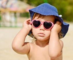 fashion toddler girl on the beach