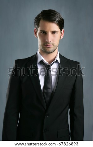 Fashion trendy elegant young black suit man posing looking camera