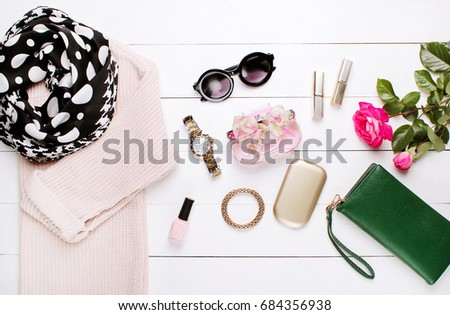 fashion. trendy sweater, beautiful scarf and wallet on a white background #684356938