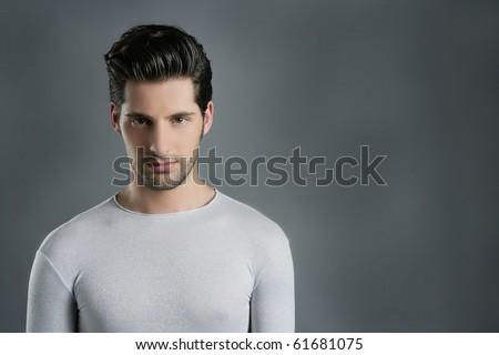 Fashion trendy young man silver futuristic  portrait over gray