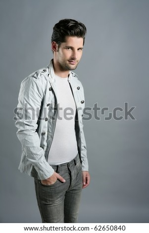 Fashion trendy young man silver  portrait over gray