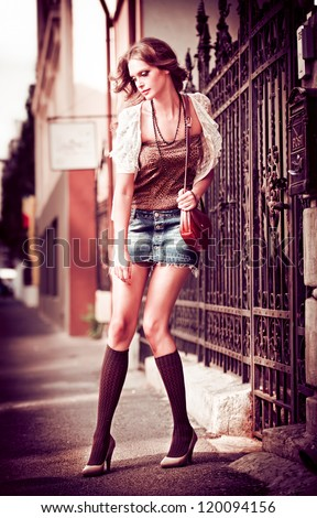 fashion urban portrait of beautiful model on the street.High fashion urban portrait of young, slim, beautiful model.