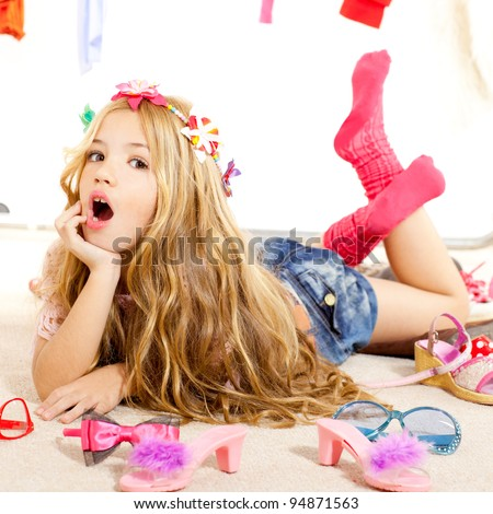 fashion victim kid girl wardrobe messy like backstage model - stock photo
