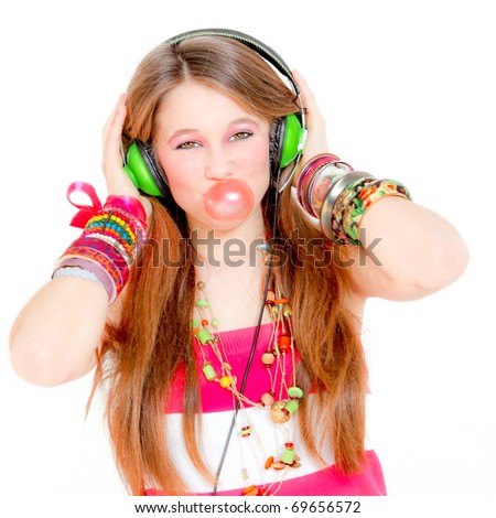 Fashion victim listening to music and blowing a bubble with gum