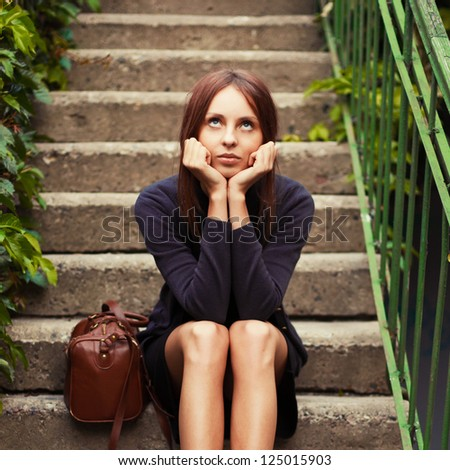 Fashion winter outdoor portrait of young beautiful brunette - stock photo