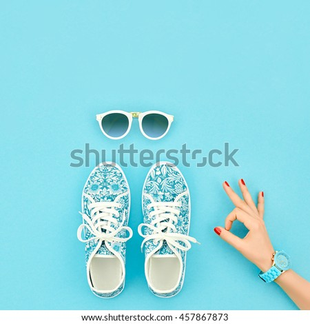 Fashion Woman Accessories Set. Female hand OK Gesture and Stylish Trendy gumshoes, Glamor Sunglasses. Summer girl Outfit. Hipster Essentials. Minimal style