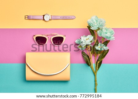Fashion Woman Accessories Set. Pastel Color. Flat lay. Trendy Yellow Handbag Clutch, Glamour Sunglasses. Blossom Flower. Luxury Spring lady. Art Design. Minimal Style - Shutterstock ID 772995184