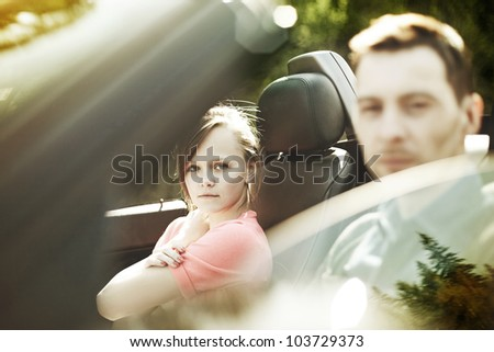 fashion woman and a man in a convertible car