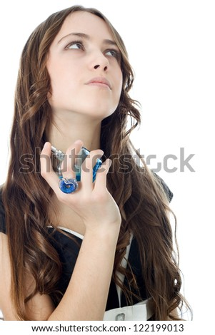Fashion woman applying perfume on her waist over white.