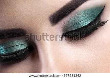 Fashion woman eye makeup. Close-up macro