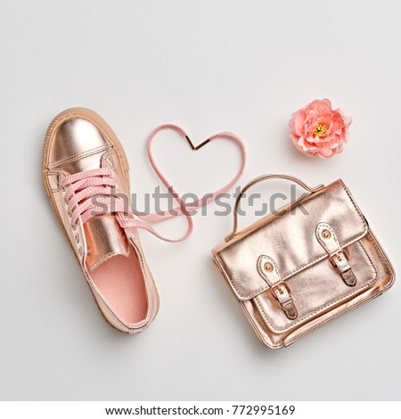Fashion. Woman Gold Accessories Set. Flat lay. Trendy fashion Handbag, Glamour Shoes, Heart, Flower. Minimal Style. Luxury Spring Hipster Girl. Love, Valentines day #772995169