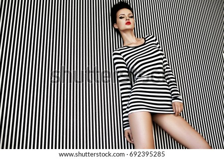 fashion woman in striped dress on  background #692395285