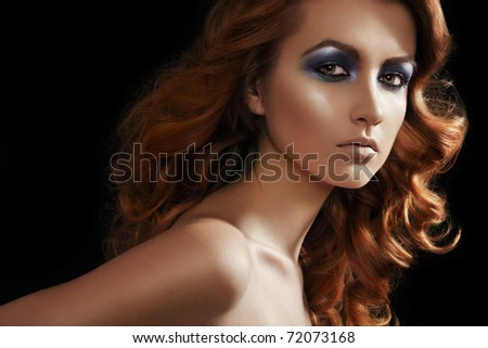 Fashion woman model with glitter evening make-up,  shiny long curly hair. Perfect night style