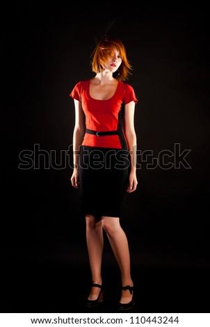 fashion woman on a black background - stock photo
