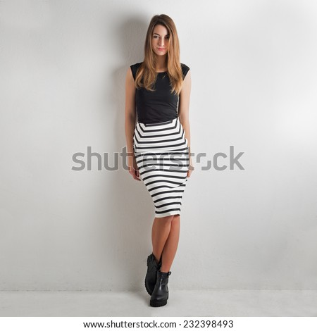 Fashion woman portrait against white wall background.