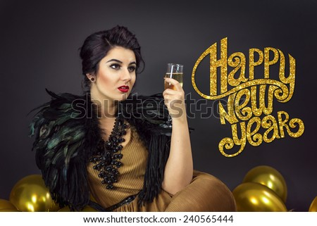 Fashion woman sitting ,drinking champagne, dressed in a gold dress and feathers collar, surrounded with yellow balloons . Happy new year copy text on the left