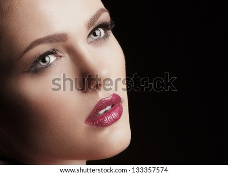 Fashion woman. Stylish makeover. Face close-up.