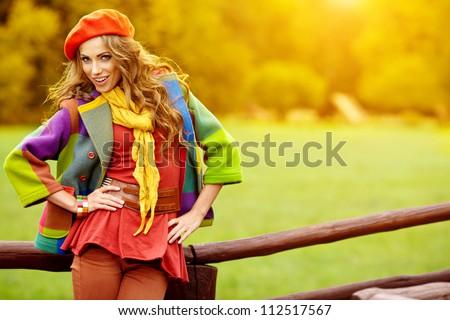 Fashion woman  walking in autumn park