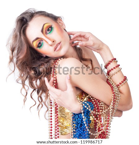 fashion woman with beauty bright make-up posing in studio witn new year beads