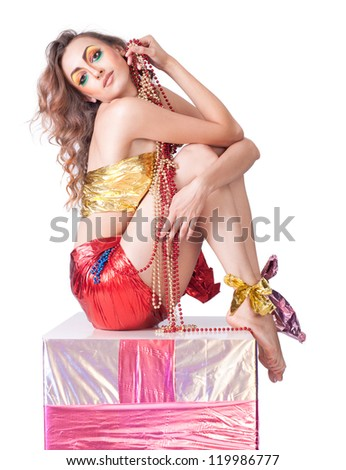 fashion woman with beauty bright make-up sitting on gift box