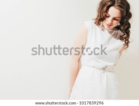 Fashion woman with freckles face, curly hair in white dress on white background - Shutterstock ID 1017839296