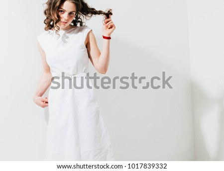 Fashion woman with freckles face, curly hair in white dress on white background - Shutterstock ID 1017839332