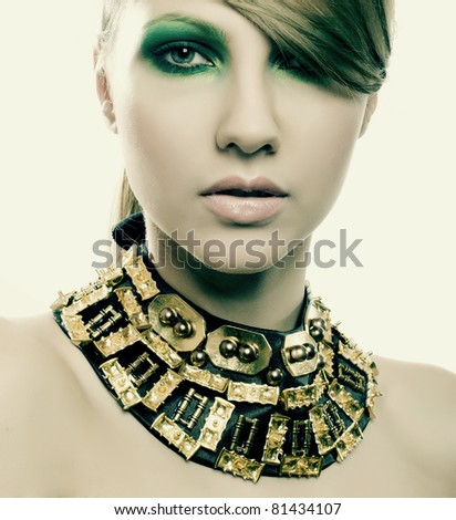 fashion woman with jewelry on light background with pearls