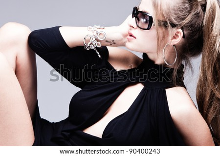 fashion woman with sunglasses portrait, profile, studio shot