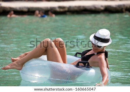 Fashion women relax in Floating On Water