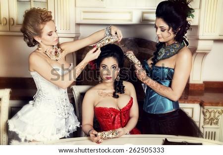 Fashion women with henna tatoo in cabaret  #262505333