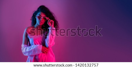 Fashion young african girl black woman wear stylish pink glasses clothes looking at camera isolated on party purple studio background, horizontal banner for website design, portrait, copy space
