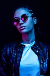 Fashion young african girl  woman wear stylish pink glasses looking at camera isolated on black studio background, horizontal banner for website design, portrait, copy space