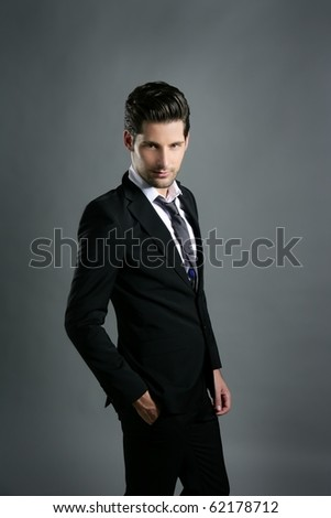 Fashion young businessman black suit casual tie on gray background