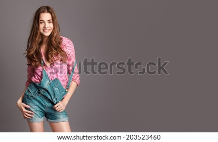 Fashion young  girl with curly shine hair