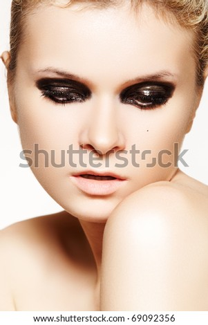 goth style makeup. with dark gloss make-up.