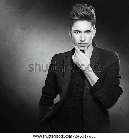 Fashion young model man portrait. Handsome Guy. Vogue style image of elegant young man. Studio fashion black and white portrait.
