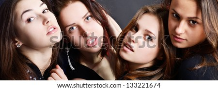 fashionable attractive party young women, over black background