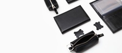 Fashionable black leather male accessories isolated on white background. Male accessories