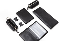 Fashionable black leather male accessories isolated on white background. Male accessories. Wallet, purse, key holder, business card holder. Top view, flat lay.
