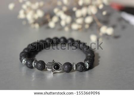 Fashionable bracelets with lava stone and pendants hamsa #1553669096