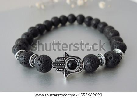 Fashionable bracelets with lava stone and pendants hamsa #1553669099
