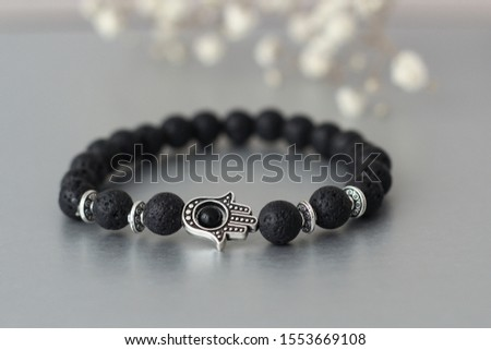 Fashionable bracelets with lava stone and pendants hamsa #1553669108