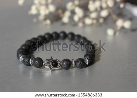 Fashionable bracelets with lava stone and pendants hamsa #1554866333