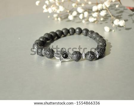 Fashionable bracelets with lava stone and pendants hamsa #1554866336