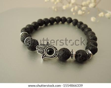 Fashionable bracelets with lava stone and pendants hamsa #1554866339