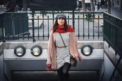 Fashionable Business Woman Walking out of City Subway in Paris.