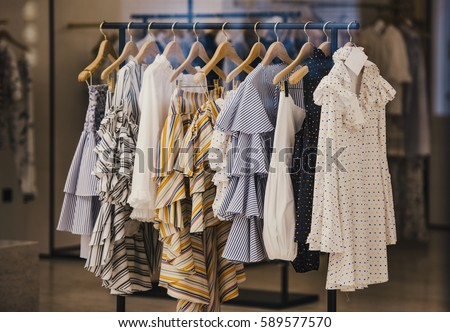 Fashionable clothes in a boutique store in London. #589577570