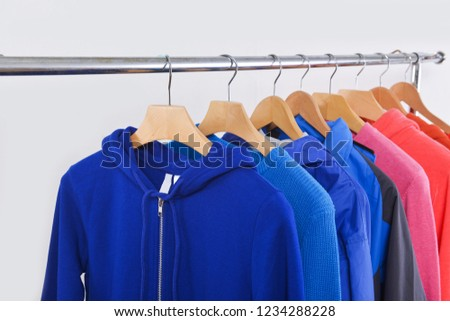 Fashionable clothing on hangers in shop. sports warm jacket are hanging on Clothes Hanger, clothes hanger with sports warm jacket.