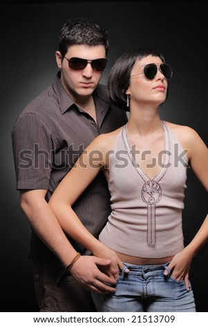 Fashionable couple against black background