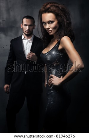 Fashionable couple in a dark room